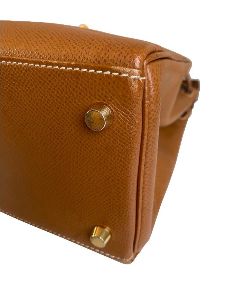 A gold Hermes Kelly in Courcheval leather with gold hardware, including Strap, Key, Lock and - Image 10 of 11