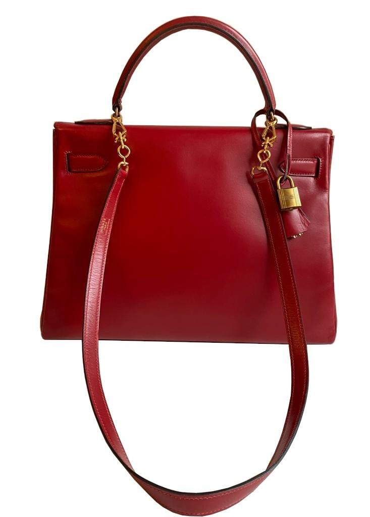 A red Hermes Kelly in tadelakt leather with gold hardware. W.32cm x H.23cm x D.10.5cm, stamped O ( - Image 4 of 7