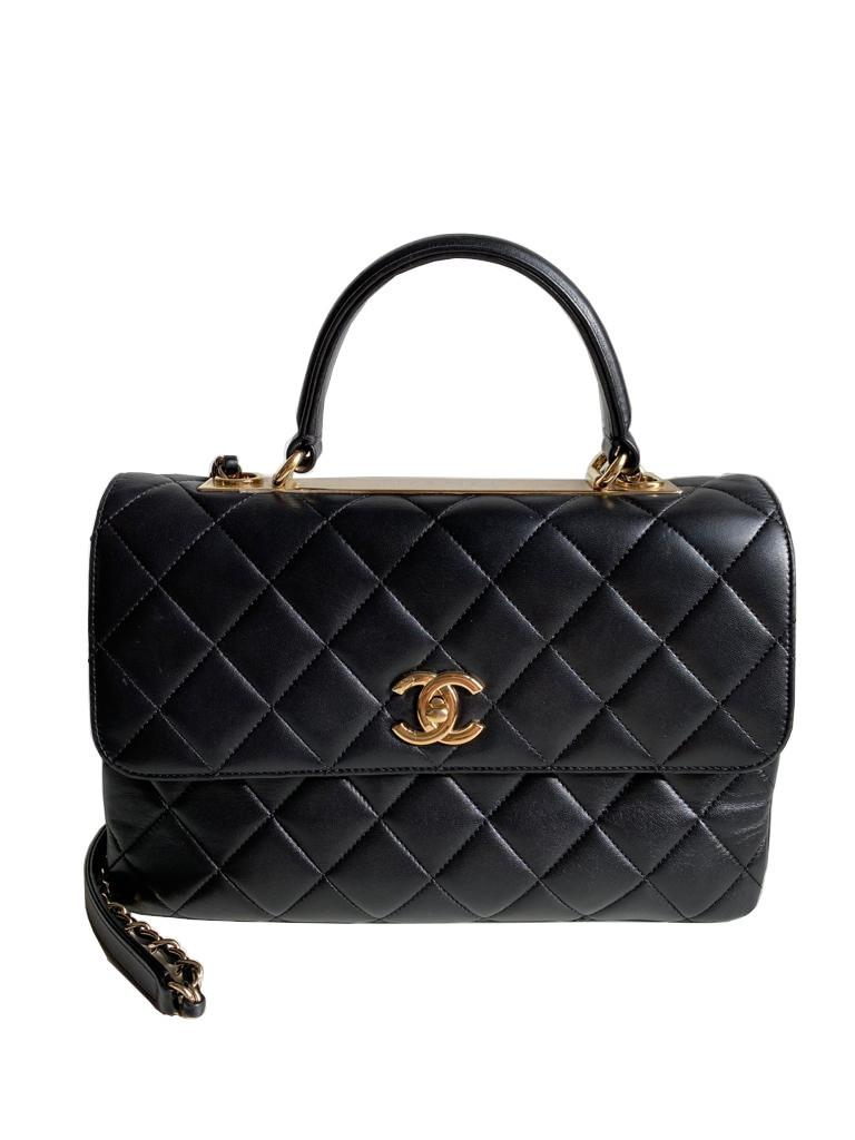 A Chanel Trendy CC in Black quilted leather with Gold Hardware, can be carried either in the hand