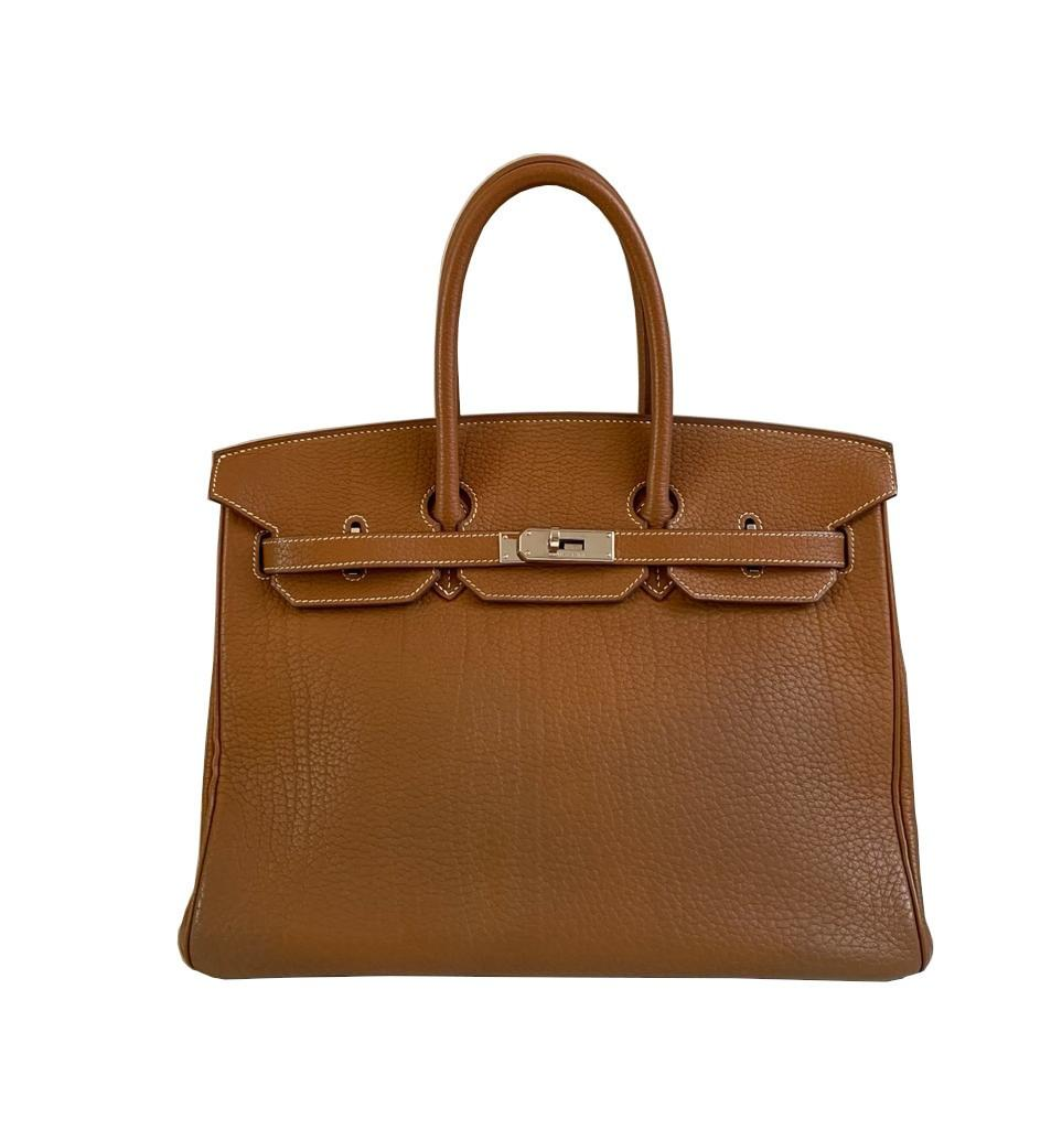 A gold Hermes Birkin in fjord leather with palladium hardware, with key, lock and spa receipt, W.