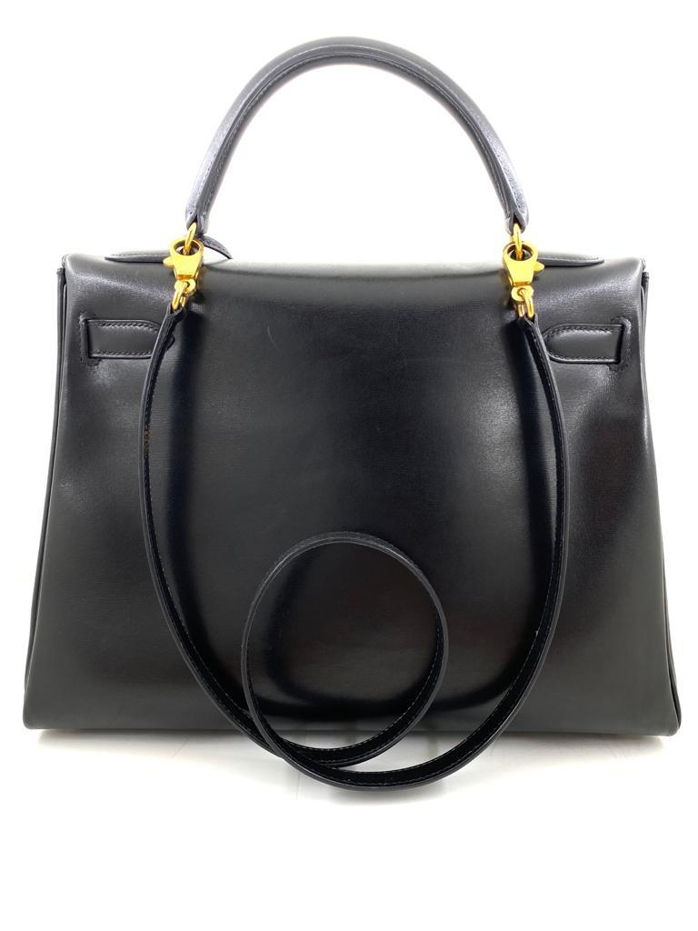A black Hermes Kelly in box leather with gold hardware, includes Dustbag, Lock, Clochette & Strap. - Image 4 of 9
