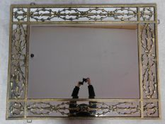 A large contemporary gilt metal overmantle or wall mirror the central rectangular plate surrounded
