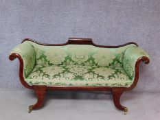 A small Regency mahogany framed scroll arm sofa in newly upholstered emerald floral damask raised on