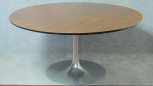 """A Maurice Burke design for Arkana rosewood dining table on """"Tulip"""" base the filled brushed aluminium"""