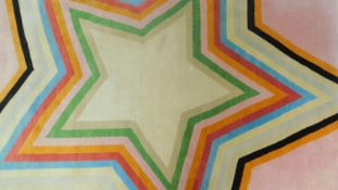 Paul Smith; handmade for the Rug Company, a carpet with large multi-coloured central star motif on