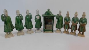 A set of Chinese Ming dynasty style earthenware attendants, together with a green glazed