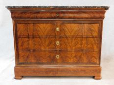 A 19th century French Louis Philippe figured mahogany commode chest with a white flecked grey marble
