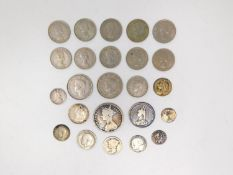 A collection of twenty four silver and white metal coins. Including silver sixpences, George VI