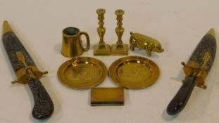 A collection of antique and vintage brass items. Including a WW1 trench art hinged book lighter with