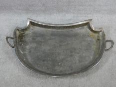 A large silver plated two handled tray with a repousse design border with oval cartouches of putti