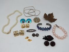 A collection of vintage jewellery. Including a pair of enamel gold plated geometric earrings, a pair