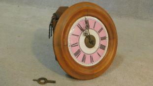 An early 20th century oak cased postman's alarm clock with coloured enamel dial, Roman numerals