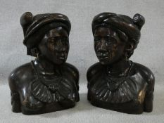 A pair of carved hardwood head and shoulder studies of an African tribal couple. H.42cm