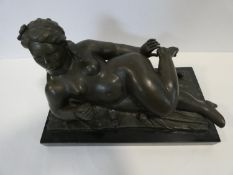 A late 20th century bronze after Fernando Botero of a reclining nude woman, signed Botero. Mounted