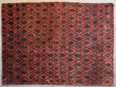 A contemporary rug with geometric diamond pattern and motifs on a burgundy field. L.220x155cm