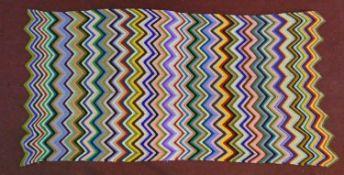 A hand knitted woollen crochet throw in multicolour geometric design. H.225xW.110cm