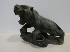 A Chinese carved greenstone figure of a prowling growling tiger on a naturalistic base. H.31xW.35cm