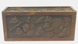 A late 19th century oak stationery casket with Arts and Crafts style floral carved panels. H.22 W.50