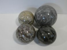 A miscellaneous collection of four various sized veined polished marble spheres. D.15cm (largest)