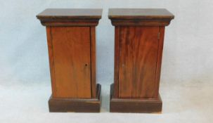 A pair of 19th century French mahogany pot cupboards with panel doors on plinth bases. H.78xW.45xL.