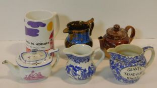 A collection of six antique and vintage jugs and tea pots. Inlcuding A Royal Doulton Lambeth Harvest