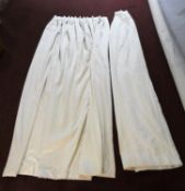 A pair of lined cream silk mix curtains with gathered tops. H.300x Widest point. 238cm