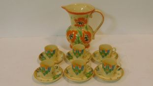 An Art Deco Minton espresso set with six cups and saucers with a bold colourful abstract design