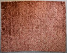 A contemporary carpet with allover scrolling interlocking pattern on a rouge field. L.240x206cm