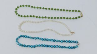 A blue cultured pearl necklace with silver ball push clasp, a serpentine and cultured pearl necklace