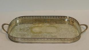 A large machine engraved two handle silver plate tray with pierced linear gallery with laurel swag