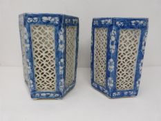 A pair of Late Qing dynasty Chinese blue ground pierced hexagonal porcelain lanterns decorated