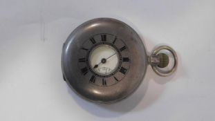 An antique silver half hunter pocket watch. Hallmarked with CN for Stauffer, Son & Co. White