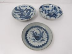 Three 18th to 19th century provincial blue and white footed dishes decorated with dragons and