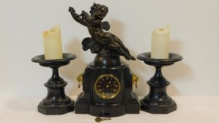 A late 19th century black marble clock garniture, the mantel clock with black enamelled dial and