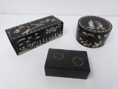 Three Chinese lacquered boxes. Two rectangular in shape the other circular, one rectangular and