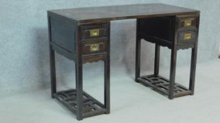 A 19th century Chinese teak three section pedestal desk fitted with two drawers to each side above