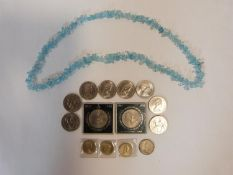 A collection of British coins together with a pale quartz chip necklace. Coins include an old