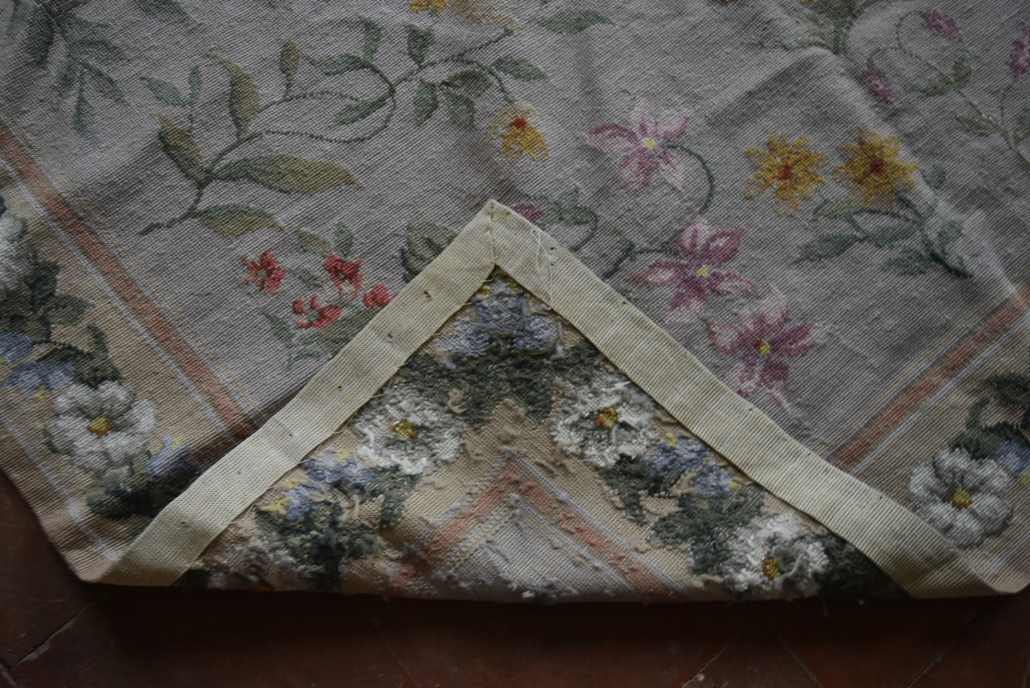A needlepoint rug with foliate and wild flower sprays across a fawn field contained by garlands of - Image 4 of 4