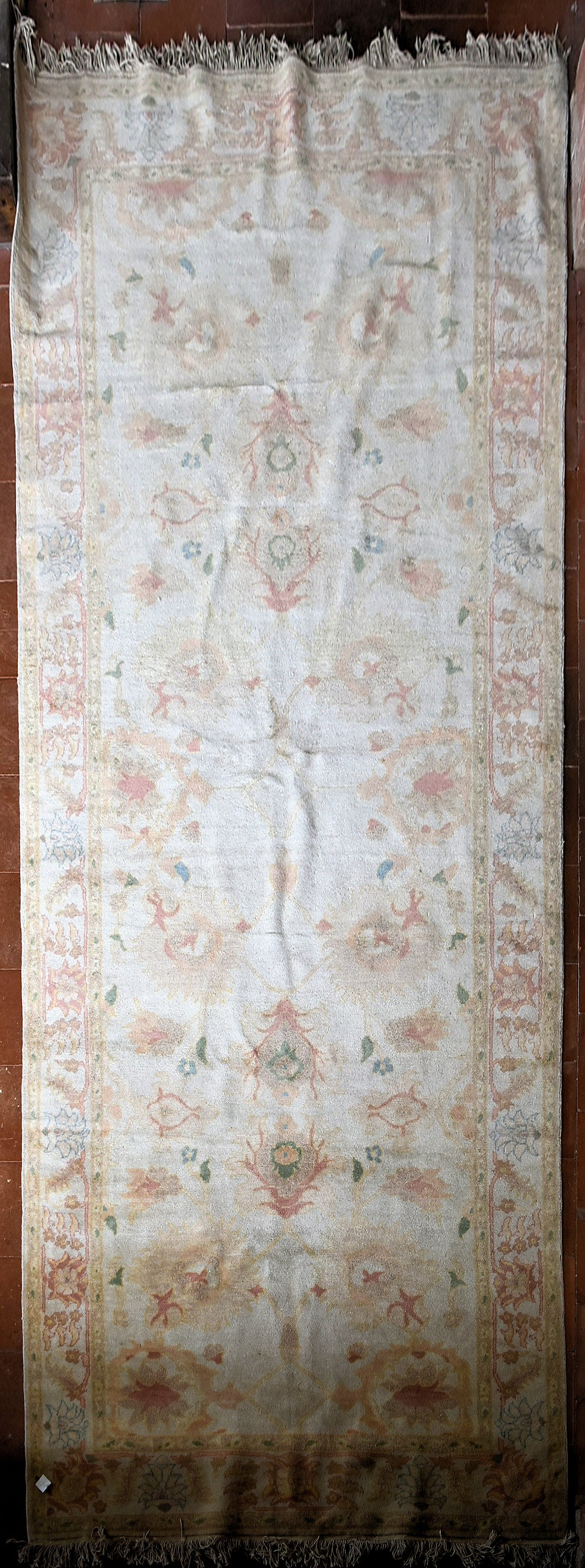 A Ziegler design carpet with repeating floral motifs across the beige field contained by a lotus and