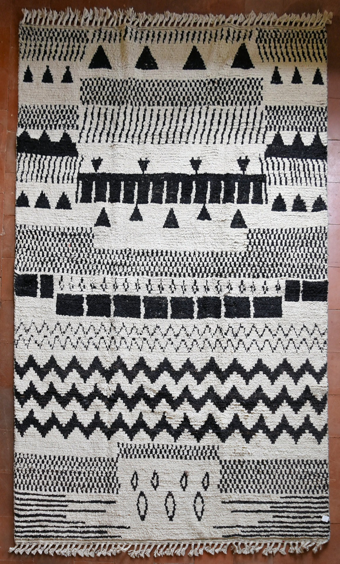 A Berber Style rug with abstract stylised geometric motifs across the field. L.273xW.182cm