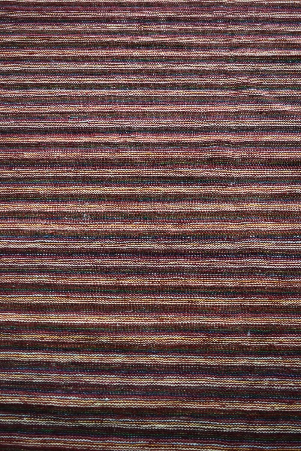 A large Modern Kilim with woven bands in hues of burgundy, cream and blue. L.332xW.247cm