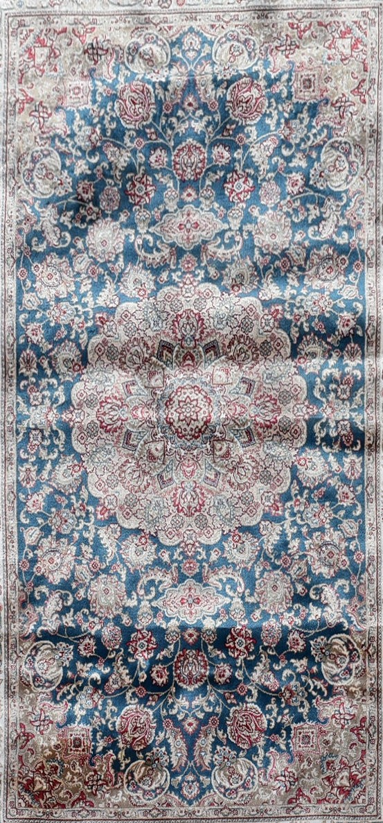 A Persian style rug with central floral medallion on a sapphire ground contained by naturalistic - Image 2 of 4