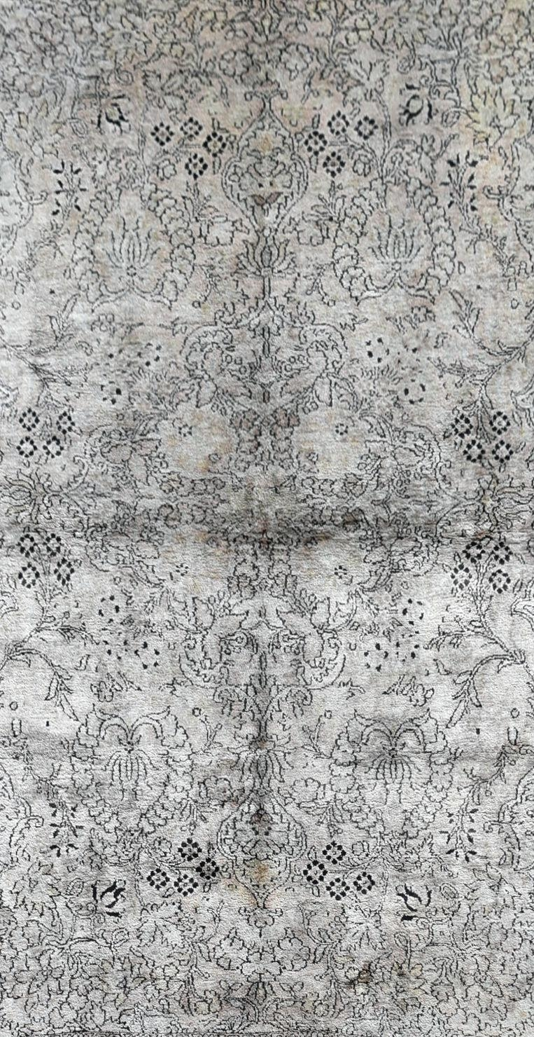 A Kashmir silk rug with all over scrolling floral design contained by foliate multi borders. L. - Image 2 of 5
