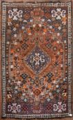 A Persian Shiraz rug with double pendant medallion within stepped flowerhead spandrels and