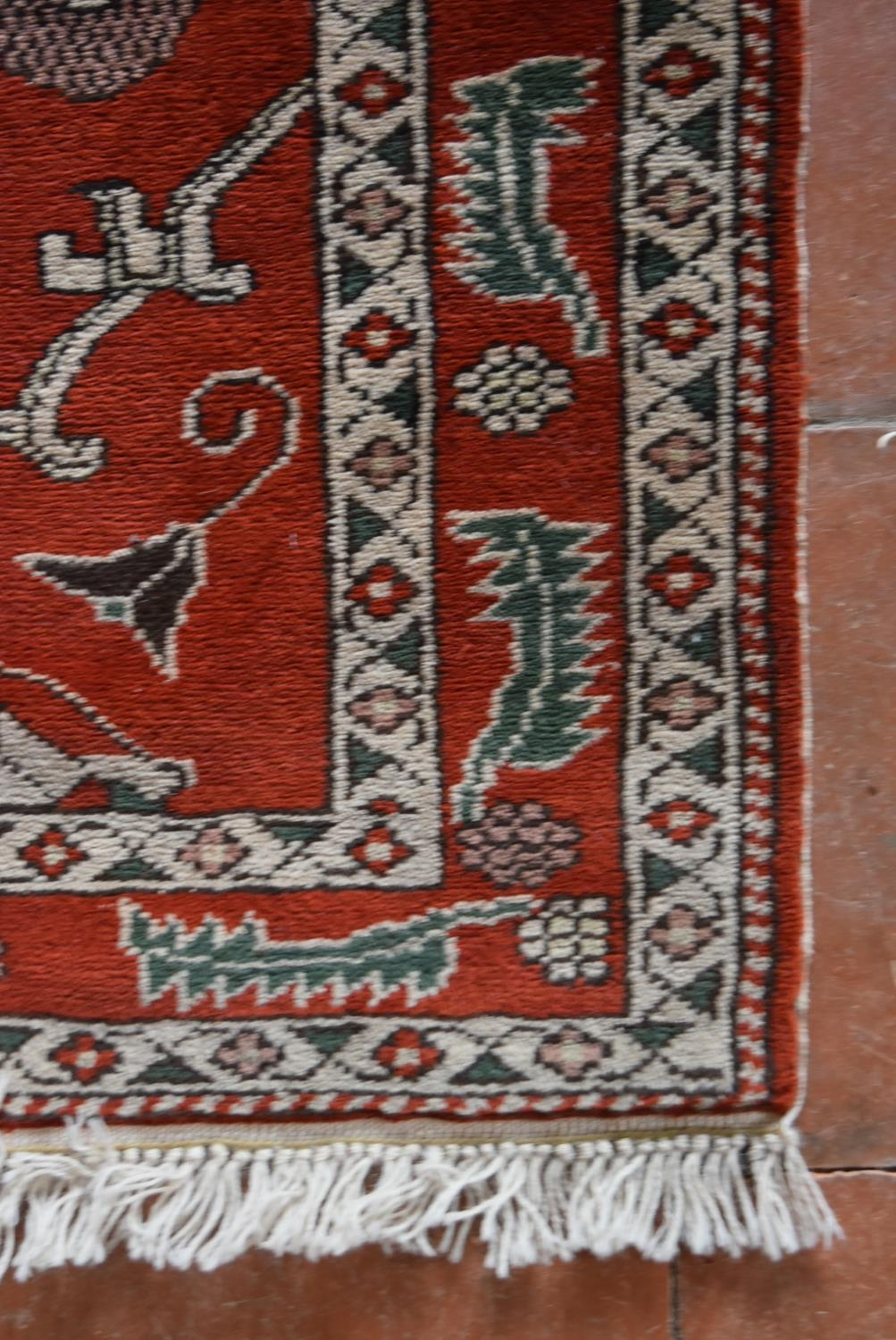 A Moughal style runner with repeating scrolling trellis central design within a border of serrated - Image 3 of 5