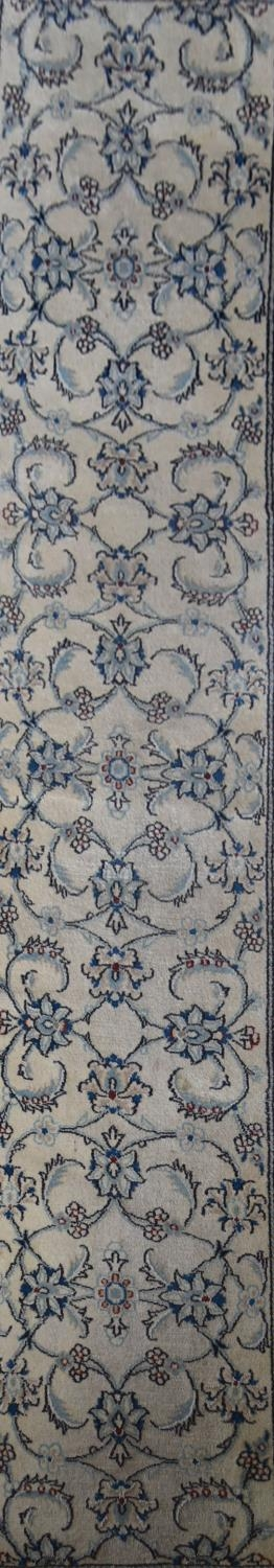 A Persian silk and wool Naiin runner with scrolling leaf and lotus pattern on the fawn ground within - Image 2 of 4