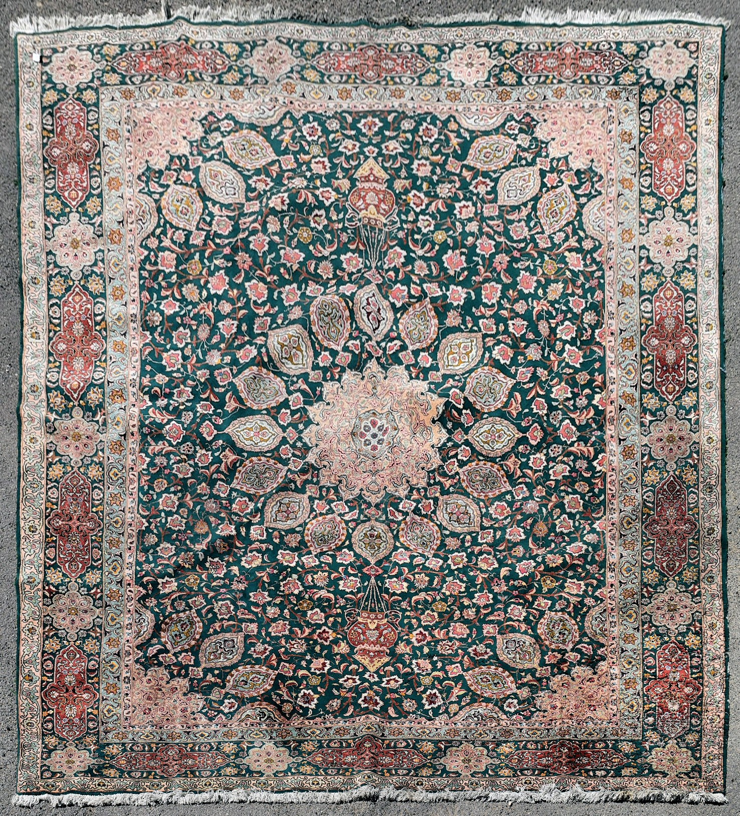 A fine Persian Tabriz carpet with central floral medallion and meandering flowerhead motifs across