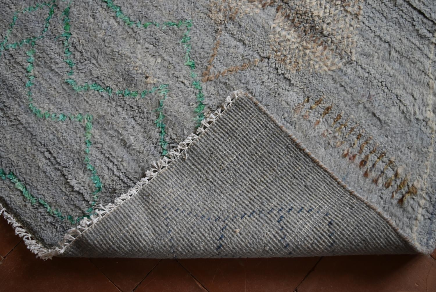 A Moroccan style rug with abstract diamond patterns across a powder blue ground. L.245xW.170cm - Image 4 of 4