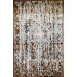 A re-dyed distressed effect Persian carpet with central diamond medallion within stylised borders.