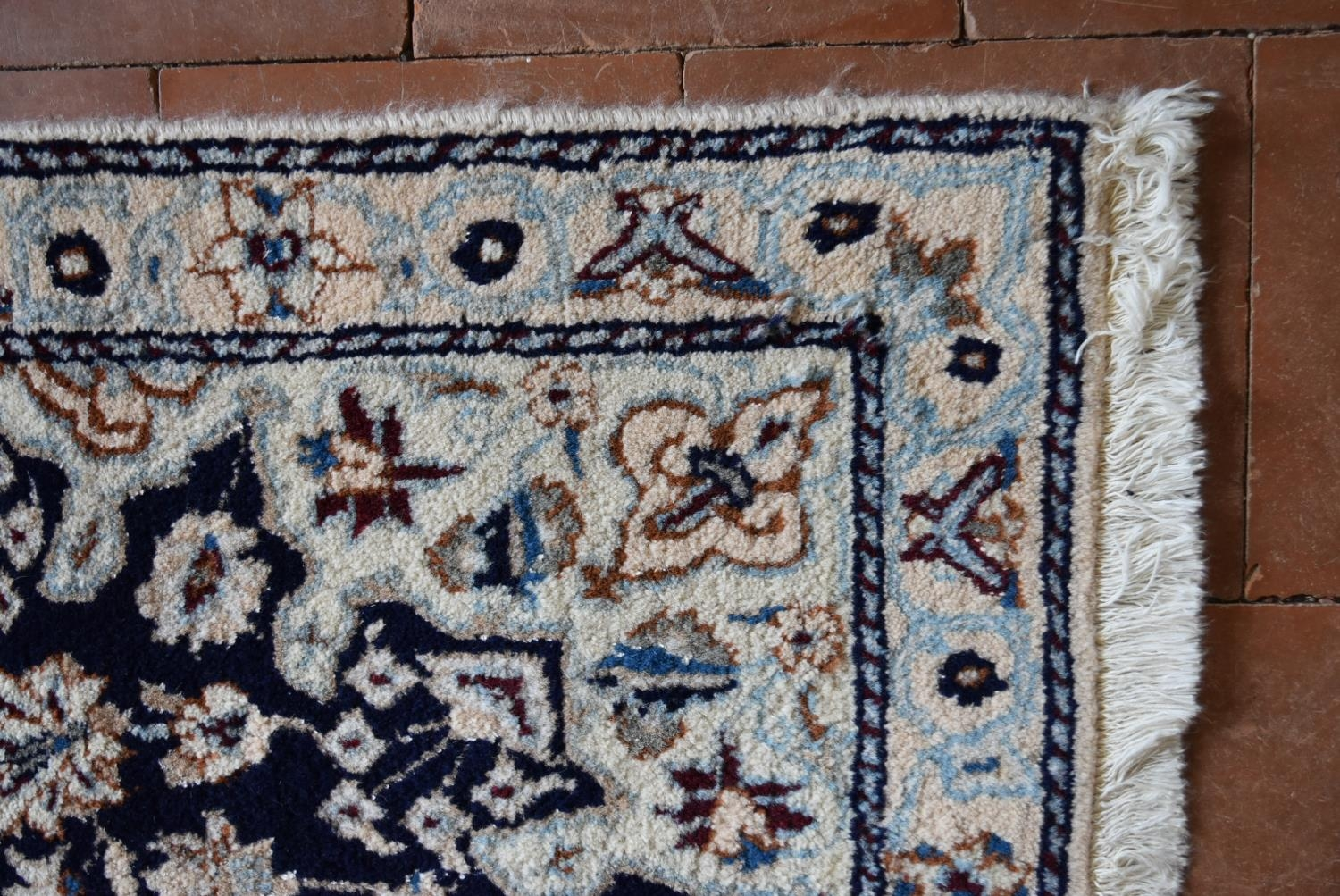 A Persian silk & wool Naiin rug with central floral medallion on a midnight ground within floral - Image 3 of 4